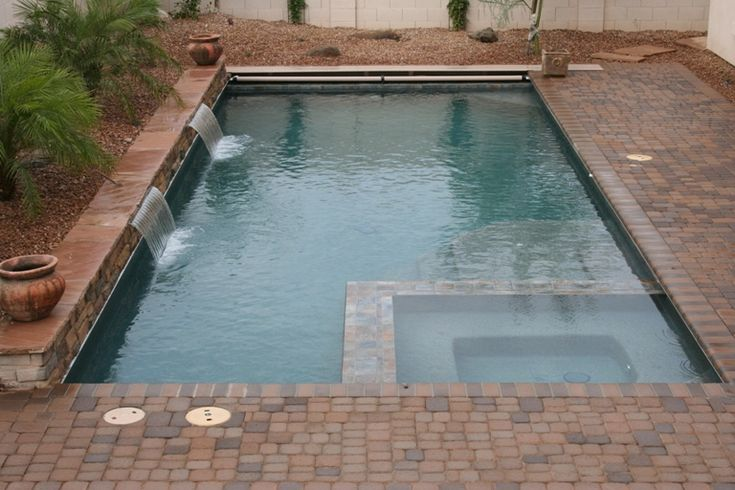 When you want a rectangular pool, a pool cover and spa can still be nestled inside!