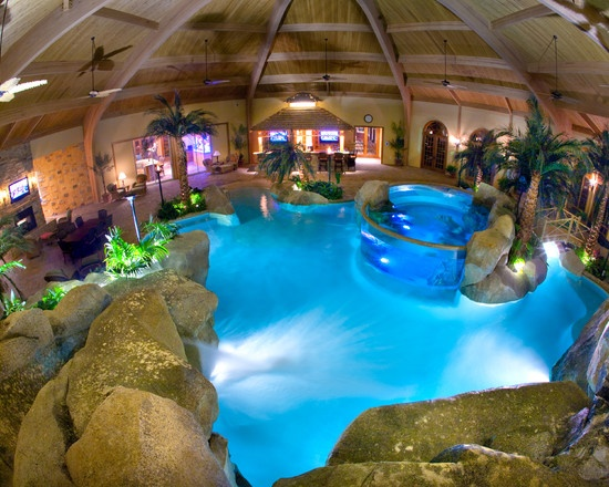 The ultimate pool grotto An Indoor pool with indoor rocks shaped like