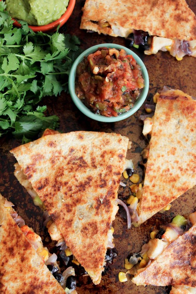 Spicy Chicken Quesadillas with Corn, Black Beans, and Caramelized Onions. Simple, nutritious and loaded with fiesta flavor!