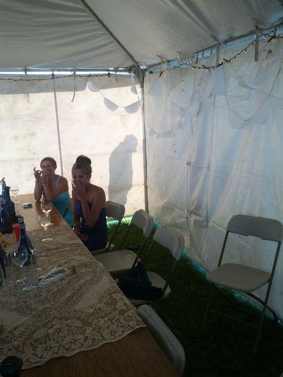 Drunk guy peeing behind tent at wedding reception.