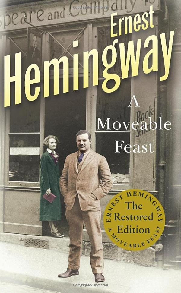 A Moveable Feast by Ernest Hemingway. (Here Hemingway poses in front of Shakespeare & Co, the library near the Seine river in Paris he used to visit.)