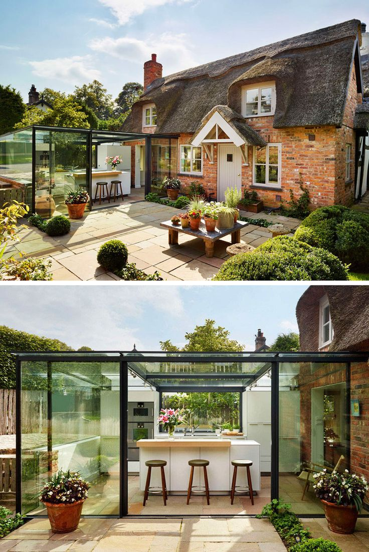 14 Examples Of British Houses With Contemporary Extensions // The thatched roof on this cottage may not be the most modern material, but the glass box extension is.