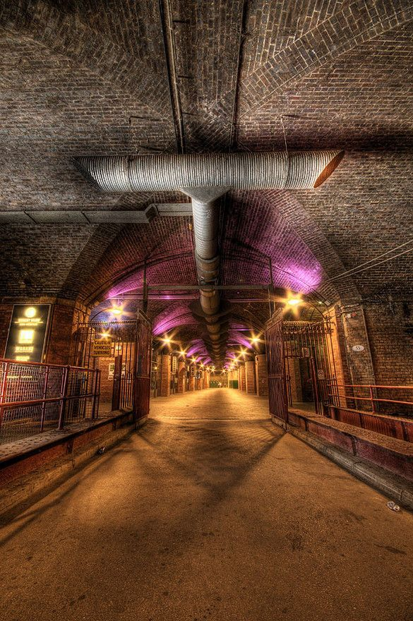 In The Dark Arches  by Taffmeister in HDR  This is the approach to whole host of shops, restaurants etc in the Dark Arches beneath Leeds City Railway Station.