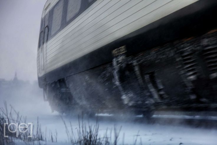 Denmark, snowy day, Train on the move - Photograph by Qe-grafik