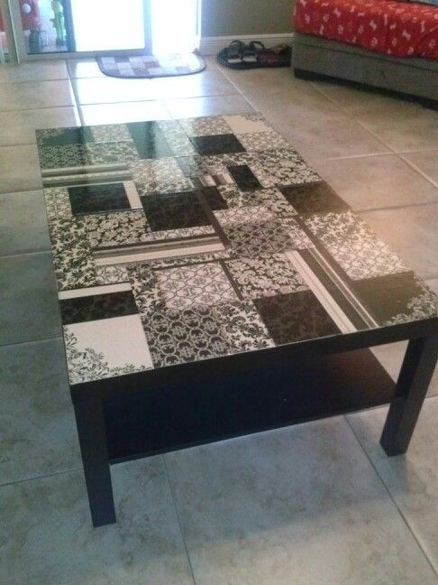 Refinished coffee table: craft paper, modge podge and polyurethane, create your own design