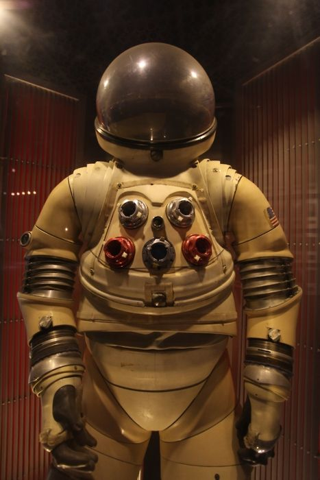 an astronaut in a space suit is motionless in outer space - photo #15