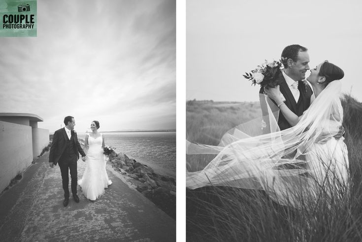 The bride & groom walk at Dollymount, while the wind blows the bride's veil. Weddings at Clontarf Castle Hotel by Couple Photography.