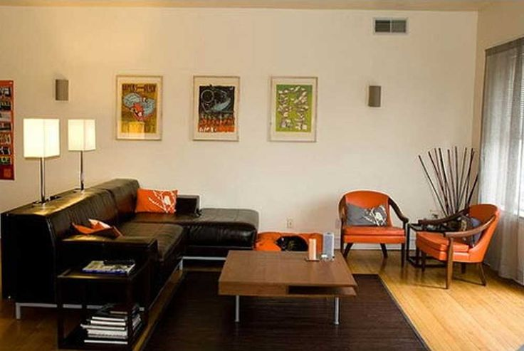 Simple Living Room Design with orange sofa and white wall