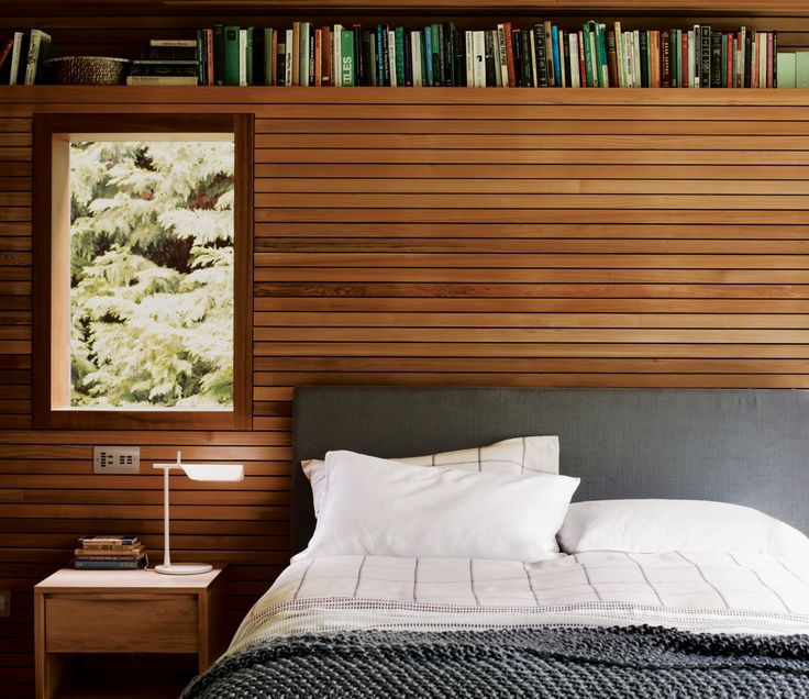 Could get a custom timber fake wall as a headboard, spaced 30mm off wall with hidden storage and mounted lights etc. Like the shelf detail at top, but this could be lower to function as bedside table...?