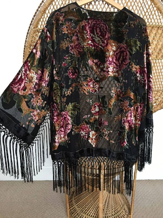 Black kimono jacket pretty floral velvet patterns on a sheer burnout fabric soft fringe hangs around hem,sleeves and chest.  measurements when laid flat top of shoulder to hem 26 plus 7 of fringe armpit to armpit 21 shoulder to end of sleeve 21 with 7 fringe width of sleeve 10 plus 7 fringe circumference of Bust 43 and waist 43  free size,wear free and open,no closure. delivery is ten days