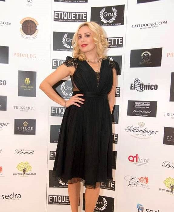 """Feminine and elegant, famous TV personality Dana Savuica chose to wear a chic cocktail CRISTALLINI dress at the event organized by Gentlemen's Club Romania and Etiquette Magazine. Delicate Chantilly Jean Bracq lace adds this """"Little Black Dress"""" a refined touch and guarantees an unforgettable appearance!"""