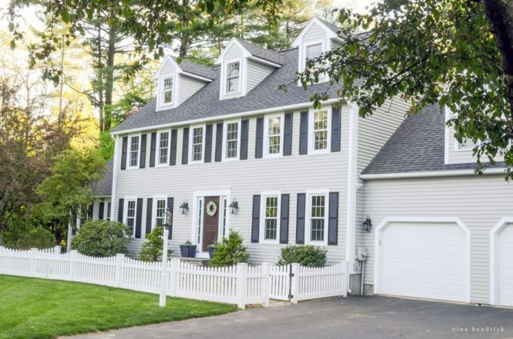 Modern Farmhouse Colonial Exterior- Modern Farmhouse Home Tour | Nina Hendrick Design Co. | Follow along as a 1980s colonial fixer upper gets a complete DIY makeover and is renovated to reflect modern farmhouse charm.