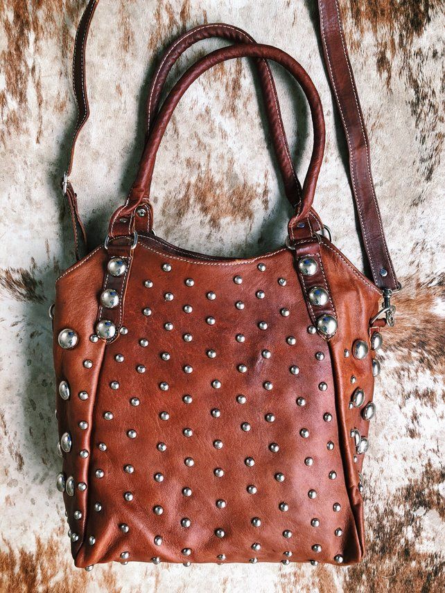 f7342cc450c32 The incredibly soft leather. The rich color of warm brick. The bold  embellished detail. This bag is a statement worth carrying - any month, ...