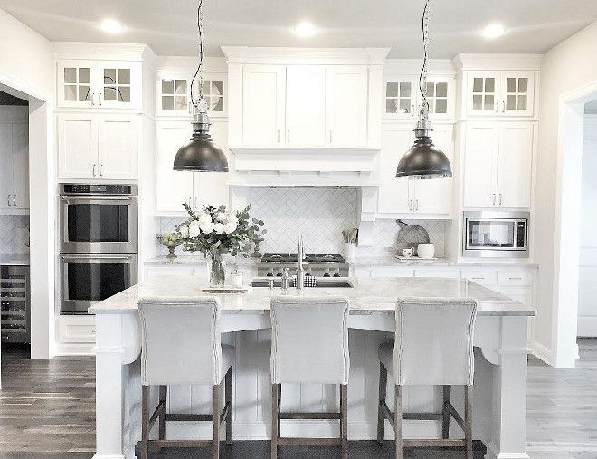 White Kitchen all white kitchen with black floor white scullery type cabinets mingle with glossy white subway tiles marble countertops and stainless steel appliances to White Pale Grey Contemporary Farmhouse Style Kitchen