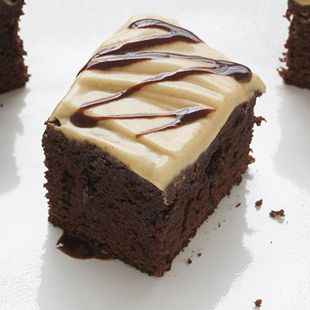 Peanut Butter Brownie Squares: Create a decadent peanut butter frosting, then drizzle our Duncan Hines Chewy Fudge Brownies with a warm milk chocolate sauce. These Peanut Butter Brownie Squares are a winning combination.
