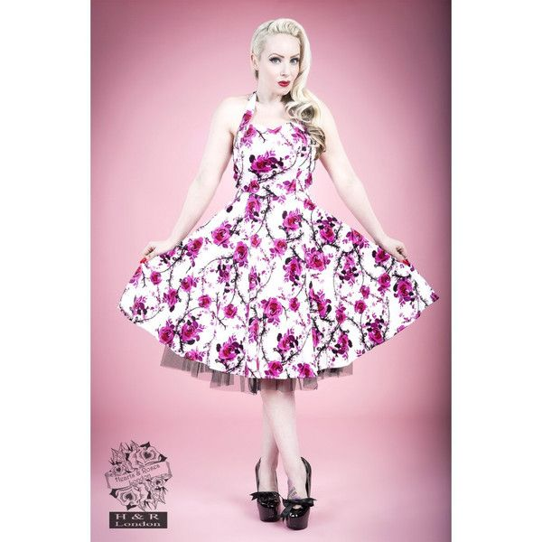 White pink floral long dress has the most gorgeous pink rose print I have ever seen.  With a halterneck, fitted bodice, flared skirt with a short black layer of tuelle popping out the bottom this dress will make all the boys and girls fall over at your feet.  97% Cotton 3% Elastic