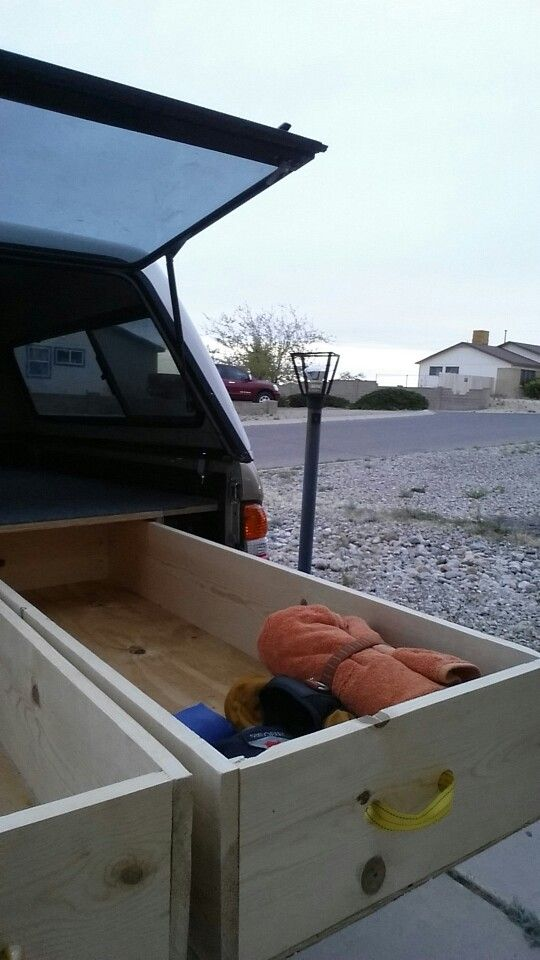 My truck build. 2004 Toyota Tacoma 4x4, manual transmission regular cab. Does great on gas mileage, and all gear stows away neatly under the bed. Two drawers are more than enough for gear for two plus dog stuff.