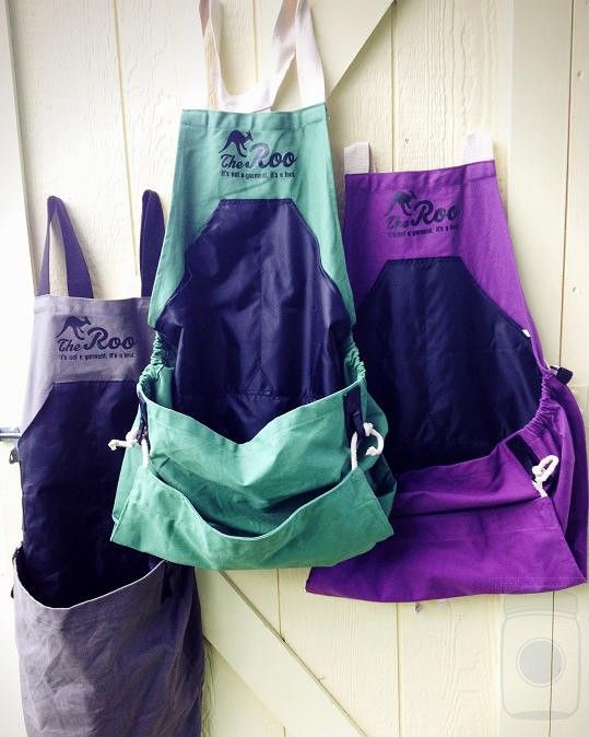 The Roo Apron, deep front pocket, a pouch that empties into your bucket, and adjustable straps - I NEED this!