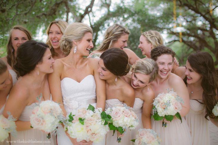 Beautiful bride and light tan bridesmaids dresses