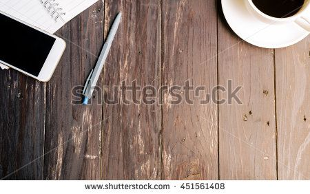 Wood Table background with Hot coffee,smartphone and notebook,Top view.vintage…