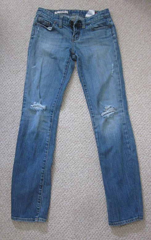 """How to get fashionably ripped jeans! She also has a tutorial on how to make flare/bootcut jeans into skinny jeans. The problem I have with all of these flares into skinnies tutorials is that they cut off the original faded seam (see the right side seam). If you do it on the inseam no one sees it, but there has to be a way of keeping that original seam, sort of like the way they do a """"euro"""" (or tricky) style hem on jeans."""