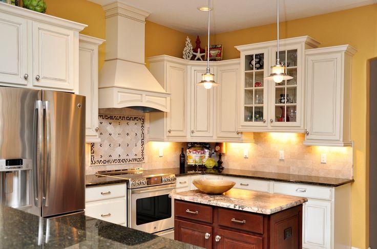 White Cabinets Dark Granite Stainless Steel Appliances Custom Tile Backslash Yellow Kitchen