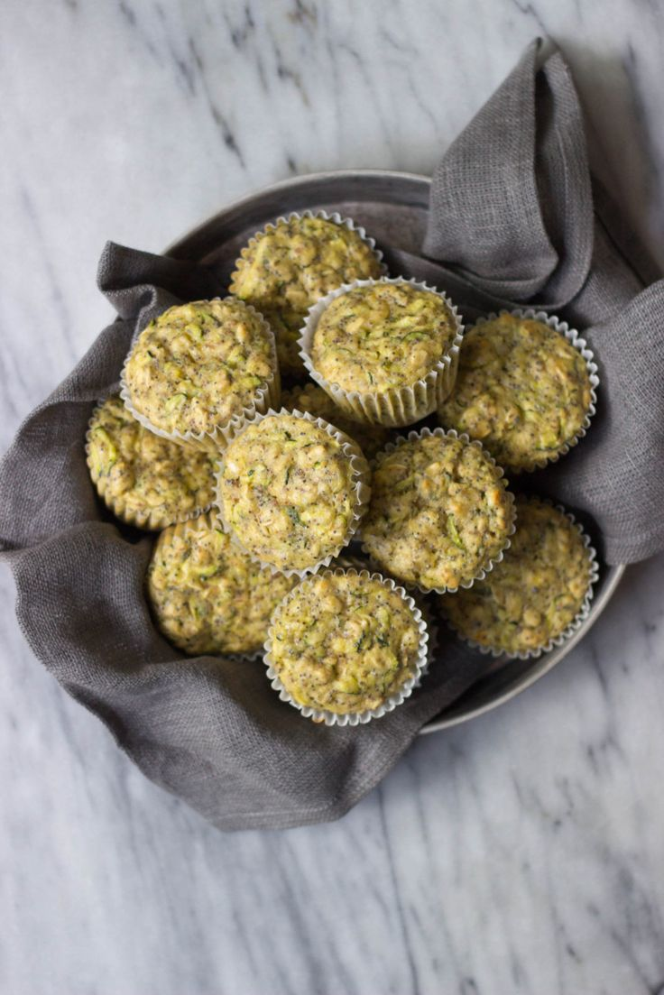Lemon poppy seed zucchini muffins with fresh lemon and poppyseeds, made with whole grain flour, flax and Greek yogurt.
