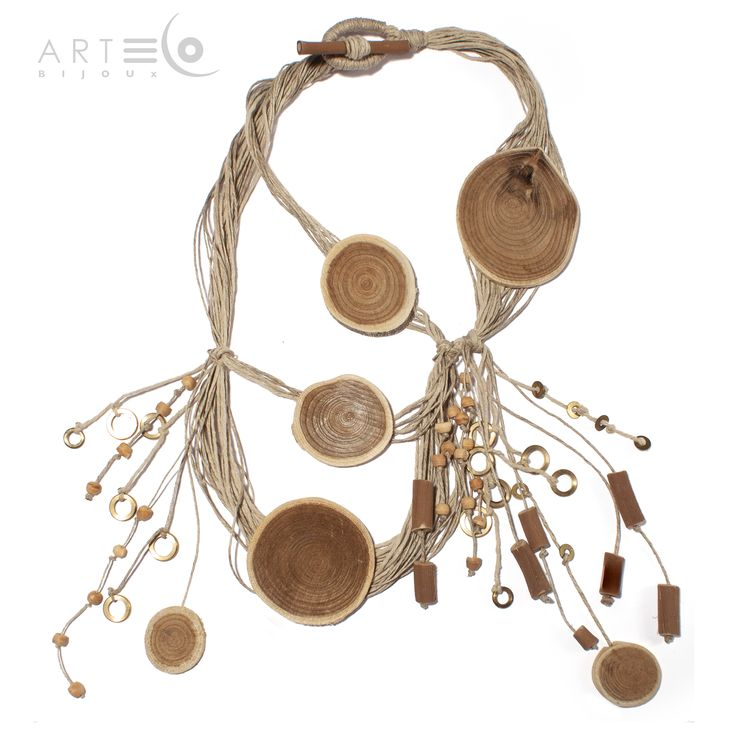 Long necklace realized with beech discs, vine-shoots, wood pearls, brass washers and rope thread. Buy it on ArtEco's Etsy shop! https://www.etsy.com/listing/201712551/long-necklace-realized-with-beech-discs