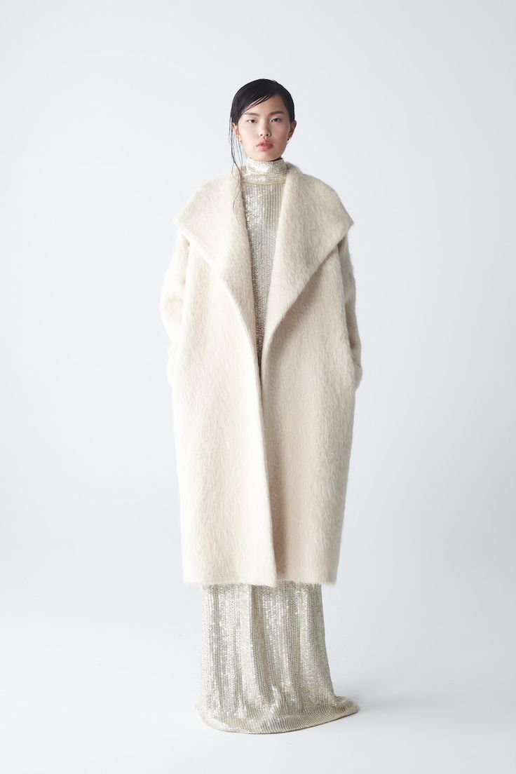 Natan Alpaca Coat with Ava Sequin Dress | NEEMIC | NOT JUST A LABEL Oversize woolly fur textured elegant topcoat in cream. The large lapels create a shawl effect and feature a delicate inner silk lining. This luxurious Alpaca overcoat also has handy side pockets for added useability.