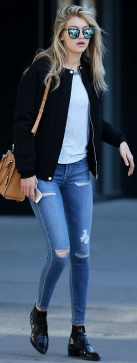 Gigi Hadid: Jacket – Pink Stitch  Jeans – a Gold E  Purse – Michael Kors  Shoes – Whistles  Sunglasses – Quay