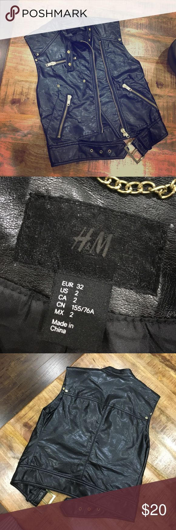H&M Black leather vest ** NEVER BEEN WORN** Black leather, gold detail. Zip up and belt buckle towards the bottom. H&M Jackets & Coats Vests