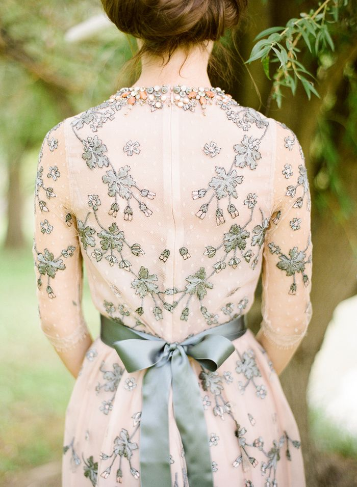 Get inspired: A beautiful sleeved grey and blush wedding dress. Perfect for a small, intimate garden celebration!