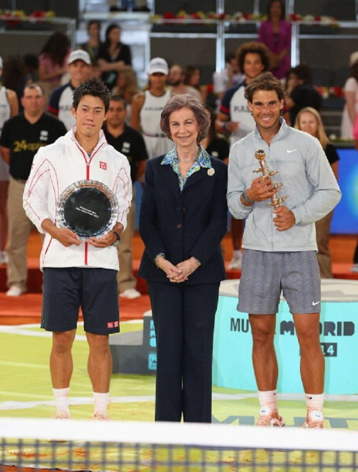 Rafael Nadal of Spain and Kei Nishikori of Japan pose for a photograph with Queen Sofia of Spain as they hold their trophies after Nishikori retired injured in the third set in their final match during day nine of the Mutua Madrid Open tennis tournament at the Caja Magica, 11.05.14 in Madrid, Spain.