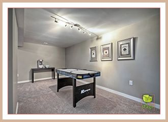 Home staging inspiration from a Calgary professional. Don't leave those bonus areas vacant when selling your home. We transformed this area into a games room, perfect for entertaining family and friends.