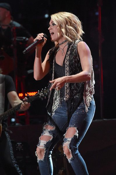 Carrie Underwood Photos Photos - Singer Carrie Underwood performs onstage during 2016 CMA Festival - Day 2 at Nissan Stadium on June 10, 2016 in Nashville, Tennessee. - 2016 CMA Music Festival - Day 2