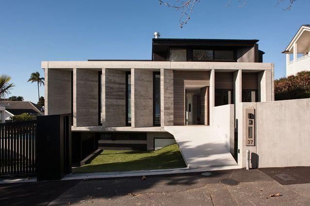 Precast concrete louvers replace the traditional front for Precast concrete home