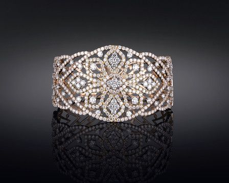 Four hundred and twenty four diamonds shimmer in this striking bangle cuff bracelet ~ M.S. Rau Antiques