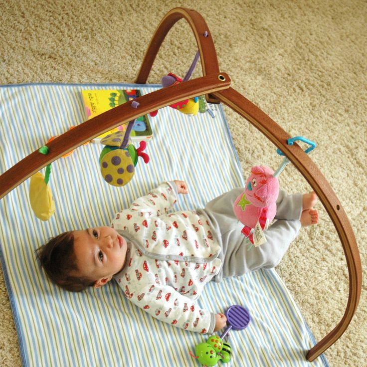 Wooden baby gym for hanging baby mobiles. $88.00, via Etsy. Folds up -- this design is amazing.