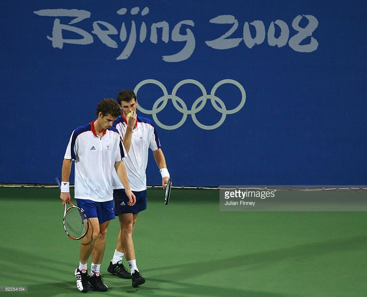 Jamie Murray (R) of Great Britain talks to brother Andy Murray in their Men's Doubles First Round match against Daniel Nestor and Frederic Niemeyer of Canada at the Olympic Green Tennis Center on Day 3 of the Beijing 2008 Olympic Games on August 11, 2008 in Beijing, China.