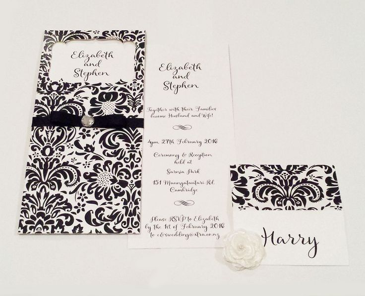 Black and White Invitation with a laser cut floral sleeve designed by Imagine If Creative Studios
