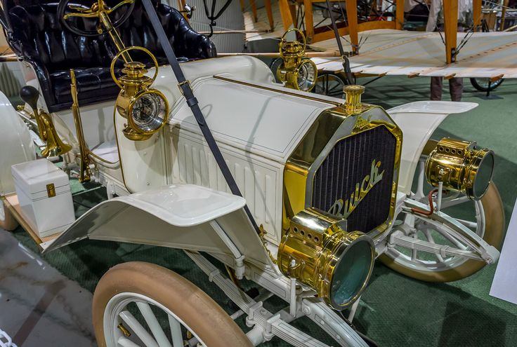 "This is an image of a very early vintage Buick Automobile at the Glenn Curtiss Museum in Hammondsport N.Y. in the Fingerlakes.  It is a model 10 1908-1909 Buick that was being made about the same time as the ""June Bug"" airplane was being flown by Glenn Curtiss.For more on the early history of Buick and this car see the link: http://oldcarandtruckpictures.com/Buick/"