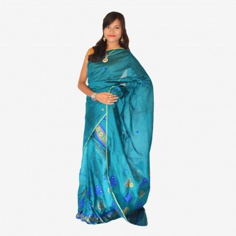 Assamese Traditional Mekhela Chador__ Padmini Peacock Color Tagar Mekhela Chador Set with Blouse Piece-  Rs. 2,114.00  The flawless beautiful Padmini Peacock Blue color Mekhela Chador gives a very classy look in itself, and when it comes for design, it is the elegant flowers that is chosen. This Mekhela Chador is a very good outfit for parties and occasions.