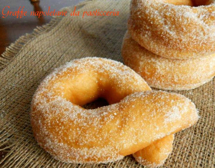 "Graffe napoletane - a knotted Neapolitan doughnut called ""braces"" (from braccia for arms http://en.wiktionary.org/wiki/brace) related to pretzels, pirashki Persian fried pastries, and paragraph parentheses see http://commons.wikimedia.org/wiki/File:Parentesi_Graffe.svg"