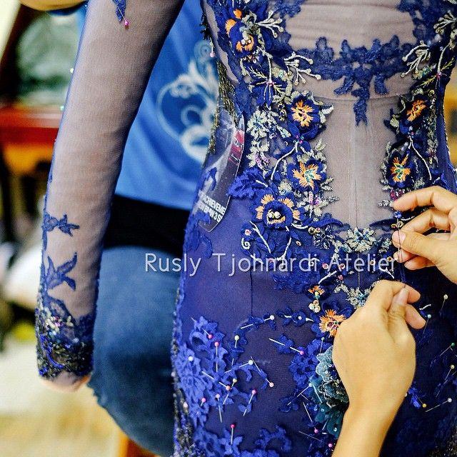 """Masterpiece in the making... #masterpiece #atelier #production #behindthescene #bespoke #lace #embroidery #handmade #handstitched #lavish #kebaya #kebayawedding #handsinframe #artisans #navyblue #blue #pantone #sapphireblue #ruslytjohnardi #ruslytjohnardiatelier"" Photo taken by @ruslytjohnardiatelier on Instagram, pinned via the InstaPin iOS App! http://www.instapinapp.com (04/11/2015)"