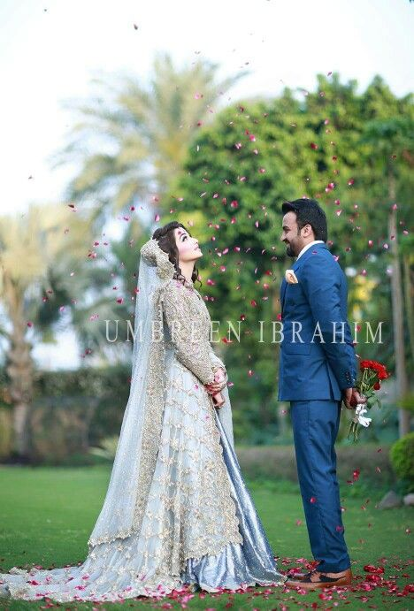 Outdoor groom with bride petals and bouquet