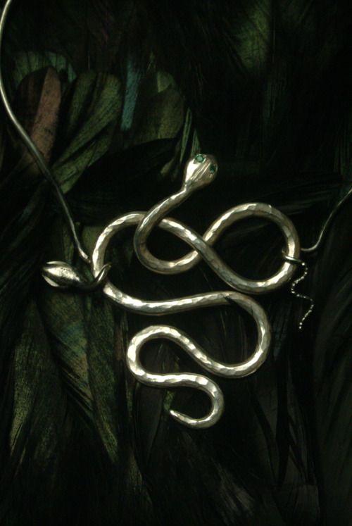 Silver serpent decoration.