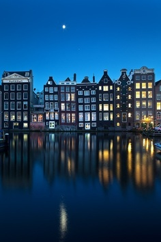 The channels of Amsterdam by night.