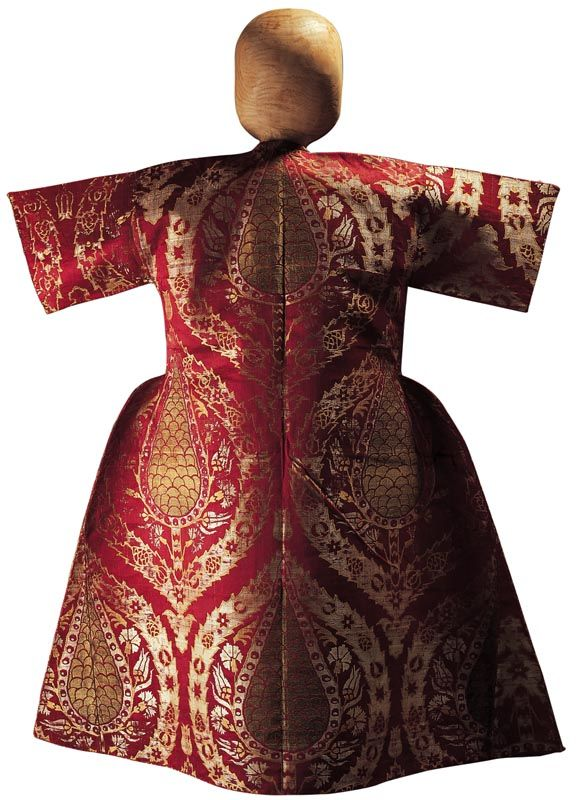 Early 17th century kaftan worn by Sultan Ahmed I (1603-1617) as a child.  Silk brocade ('kemha').The composition consist of pine cones in the form of stylised cypress trees woven in gold, surrounded by tulips and carnations and set in floral medallions with tulip finials. (TOPKAPI PALACE MUSEUM).