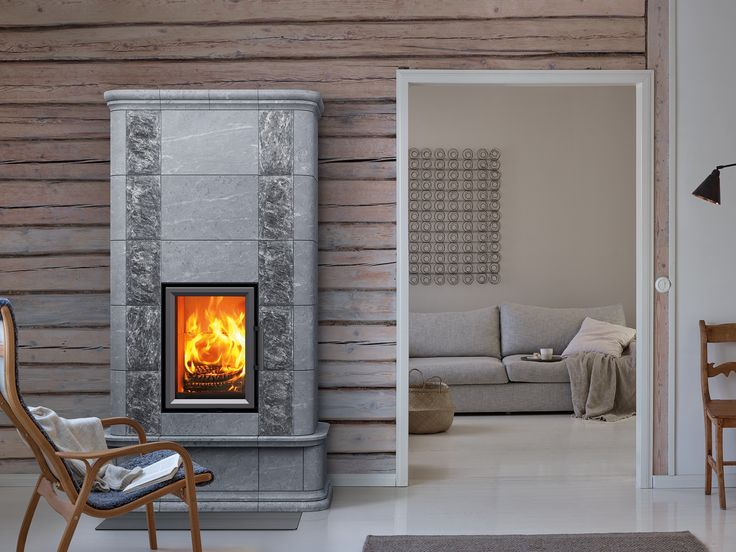 Otra shares a common design with the Akko masonry heater. The narrower Otra fireplace is equipped with a high, vertically oriented door.