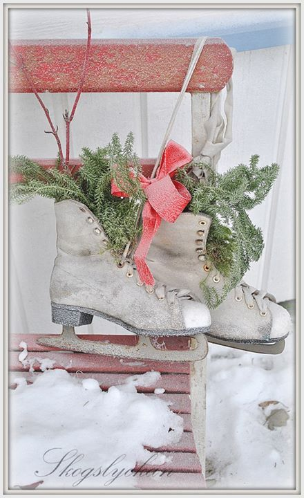 Dress up an old pair of ice skates with evergreen and ribbon for an outdoor decoration